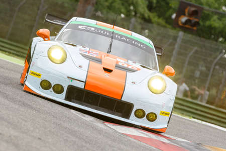 enzo: Imola, Italy May 16, 2015: Porsche 911 RSR of GULF RACING UK Team, driven by Michael Wainwright - Adam Carroll - Philip Keen in action During The European Le Mans Series - 4 Hours of Imola Autodromo Dino Ferrari Enzo on May 16, 2015 in Imola, Italy. Editorial