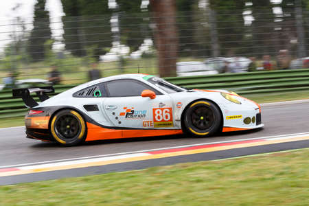 keen: Imola, Italy May 16, 2015: Porsche 911 RSR of GULF RACING UK Team, driven by Michael Wainwright - Adam Carroll - Philip Keen in action During The European Le Mans Series - 4 Hours of Imola Autodromo Dino Ferrari Enzo on May 16, 2015 in Imola, Italy. Editorial