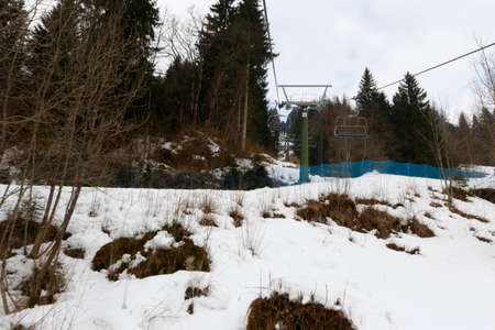 chairlift: Falcade, Belluno, Italy - March 21, 2015: 4-seater chairlift Molino - Le Buse now removed in the Dolomite Alps ski area San Pellegrino