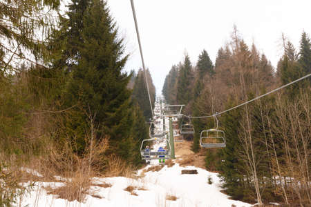 Ski Area: Falcade, Belluno, Italy - March 21, 2015: 4-seater chairlift Molino - Le Buse now removed in the Dolomite Alps ski area San Pellegrino