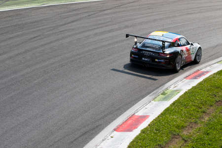 rt: Monza, Italy - May 30, 2015: Porsche 911 GT3 Cup of Tsunami RT team, driven  by LEDOGAR Come during the Porsche Carrera Cup Italia - Race in Autodromo Nazionale di Monza Circuit on May 30, 2015 in Monza, Italy.