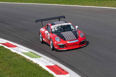 carrera: Monza, Italy - May 30, 2015: Porsche 911 GT3 Cup of TAM-Racing team, driven  by Hans-Peter Koller during the Porsche Carrera Cup Italia - Race in Autodromo Nazionale di Monza Circuit on May 30, 2015 in Monza, Italy.