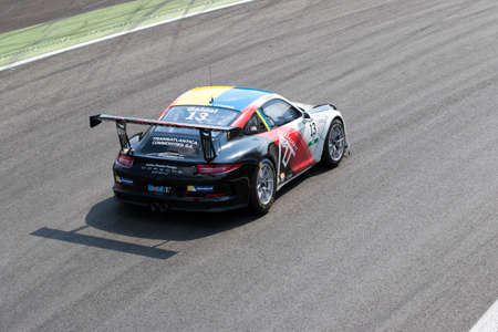 carrera: Monza, Italy - May 30, 2015: Porsche 911 GT3 Cup of Tsunami RT team, driven  by GAIDAI Oleksandr during the Porsche Carrera Cup Italia - Race in Autodromo Nazionale di Monza Circuit on May 30, 2015 in Monza, Italy.