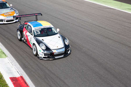 rt: Monza, Italy - May 30, 2015: Porsche 911 GT3 Cup of Tsunami RT team, driven  by GAIDAI Oleksandr during the Porsche Carrera Cup Italia - Race in Autodromo Nazionale di Monza Circuit on May 30, 2015 in Monza, Italy.
