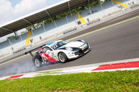 monza: Monza, Italy - May 30, 2015: Porsche 911 GT3 Cup of Tsunami RT team, driven  by LEDOGAR Come during the Porsche Carrera Cup Italia - Race in Autodromo Nazionale di Monza Circuit on May 30, 2015 in Monza, Italy.