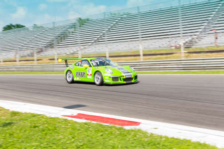 monza: Monza, Italy - May 30, 2015: Porsche 911 GT3 Cup of Dinamic Motorsport team, driven  by DE GIACOMI Alex during the Porsche Carrera Cup Italia - Race in Autodromo Nazionale di Monza Circuit on May 30, 2015 in Monza, Italy.