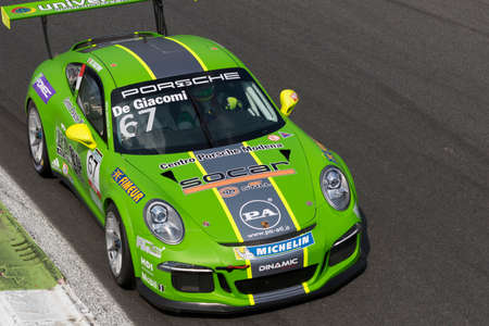 carrera: Monza, Italy - May 30, 2015: Porsche 911 GT3 Cup of Dinamic Motorsport team, driven  by DE GIACOMI Alex during the Porsche Carrera Cup Italia - Race in Autodromo Nazionale di Monza Circuit on May 30, 2015 in Monza, Italy.