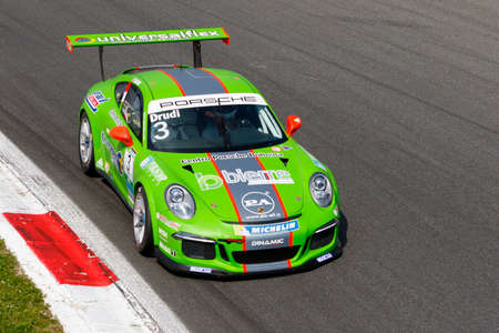 monza: Monza, Italy - May 30, 2015: Porsche 911 GT3 Cup of Dinamic Motorsport team, driven  by DRUDI Mattia during the Porsche Carrera Cup Italia - Race in Autodromo Nazionale di Monza Circuit on May 30, 2015 in Monza, Italy. Editorial