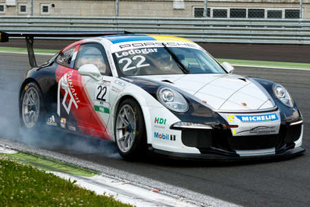 carrera: Monza, Italy - May 30, 2015: Porsche 911 GT3 Cup of Tsunami RT team, driven  by LEDOGAR Come during the Porsche Carrera Cup Italia - Race in Autodromo Nazionale di Monza Circuit on May 30, 2015 in Monza, Italy.