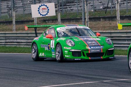 carrera: Monza, Italy - May 30, 2015: Porsche 911 GT3 Cup of Dinamic Motorsport team, driven  by DRUDI Mattia during the Porsche Carrera Cup Italia - Race in Autodromo Nazionale di Monza Circuit on May 30, 2015 in Monza, Italy. Editorial