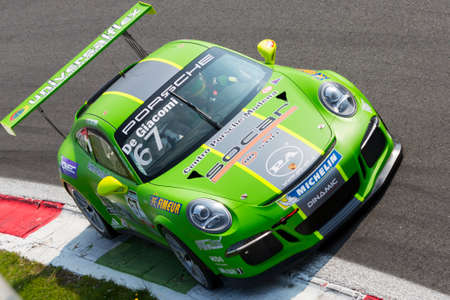 gt3: Monza, Italy - May 30, 2015: Porsche 911 GT3 Cup of Dinamic Motorsport team, driven  by DE GIACOMI Alex during the Porsche Carrera Cup Italia - Race in Autodromo Nazionale di Monza Circuit on May 30, 2015 in Monza, Italy.