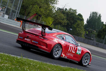 monza: Monza, Italy - May 30, 2015: Porsche 911 GT3 Cup of TAM-Racing team, driven  by Hans-Peter Koller during the Porsche Carrera Cup Italia - Race in Autodromo Nazionale di Monza Circuit on May 30, 2015 in Monza, Italy.