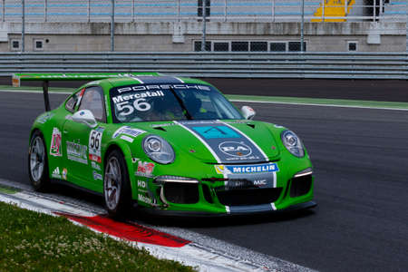 monza: Monza, Italy - May 30, 2015: Porsche 911 GT3 Cup of Dinamic Motorsport  team, driven  by Niccolò Mercatali during the Porsche Carrera Cup Italia - Race in Autodromo Nazionale di Monza Circuit on May 30, 2015 in Monza, Italy.
