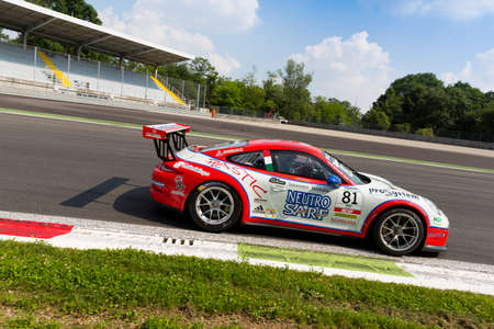 monza: Monza, Italy - May 30, 2015: Porsche 911 GT3 Cup of Ghinzani Arco Motorsport team, driven  by Marco Cassarà during the Porsche Carrera Cup Italia - Race in Autodromo Nazionale di Monza Circuit on May 30, 2015 in Monza, Italy. Editorial