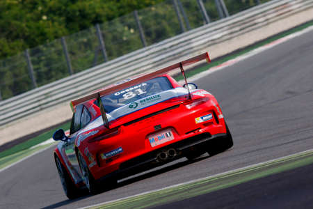 monza: Monza, Italy - May 30, 2015: Porsche 911 GT3 Cup of Ghinzani Arco Motorsport team, driven  by Marco Cassarà during the Porsche Carrera Cup Italia - Race in Autodromo Nazionale di Monza Circuit on May 30, 2015 in Monza, Italy.