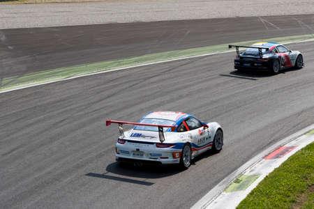 carrera: Monza, Italy - May 30, 2015: Porsche 911 GT3 Cup of Lem Racing - Centri Porsche Di Milano team, driven  by Da Sheng Zhang during the Porsche Carrera Cup Italia - Race in Autodromo Nazionale di Monza Circuit on May 30, 2015 in Monza, Italy.