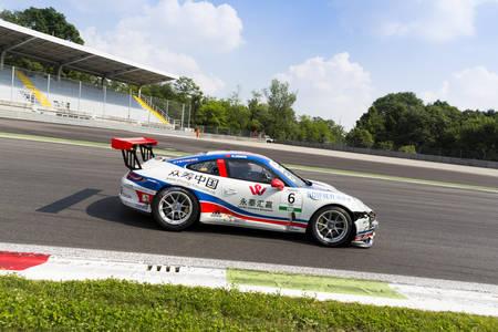 monza: Monza, Italy - May 30, 2015: Porsche 911 GT3 Cup of Lem Racing - Centri Porsche Di Milano team, driven  by Da Sheng Zhang during the Porsche Carrera Cup Italia - Race in Autodromo Nazionale di Monza Circuit on May 30, 2015 in Monza, Italy.