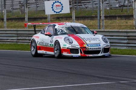 takashi: Monza, Italy - May 30, 2015: Porsche 911 GT3 Cup of Antonelli Motorsport - Centro Porsche Padova team, driven  by Takashi Kasai during the Porsche Carrera Cup Italia - Race in Autodromo Nazionale di Monza Circuit on May 30, 2015 in Monza, Italy.
