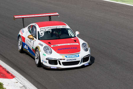 carrera: Monza, Italy - May 30, 2015: Porsche 911 GT3 Cup of Ghinzani Arco Motorsport team, driven  by Andrea Fontana during the Porsche Carrera Cup Italia - Race in Autodromo Nazionale di Monza Circuit on May 30, 2015 in Monza, Italy.