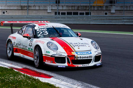 gt3: Monza, Italy - May 30, 2015: Porsche 911 GT3 Cup of Antonelli Motorsport - Centro Porsche Padova team, driven  by Takashi Kasai during the Porsche Carrera Cup Italia - Race in Autodromo Nazionale di Monza Circuit on May 30, 2015 in Monza, Italy.