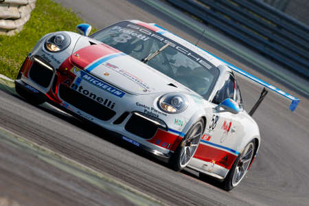 carrera: Monza, Italy - May 30, 2015: Porsche 911 GT3 Cup of Antonelli Motorsport - Centro Porsche Padova team, driven  by Angelo Proietti during the Porsche Carrera Cup Italia - Race in Autodromo Nazionale di Monza Circuit on May 30, 2015 in Monza, Italy. Editorial