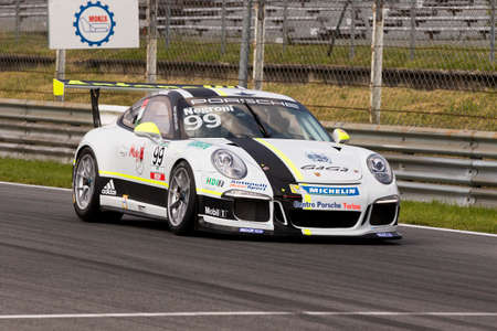 sergio: Monza, Italy - May 30, 2015: Porsche 911 GT3 Cup of Antonelli Motorsport - Centro Porsche Padova team, driven  by Sergio Negroni during the Porsche Carrera Cup Italia - Race in Autodromo Nazionale di Monza Circuit on May 30, 2015 in Monza, Italy.