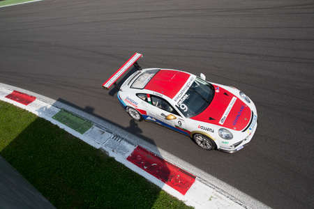 monza: Monza, Italy - May 30, 2015: Porsche 911 GT3 Cup of Ghinzani Arco Motorsport team, driven  by Andrea Fontana during the Porsche Carrera Cup Italia - Race in Autodromo Nazionale di Monza Circuit on May 30, 2015 in Monza, Italy.