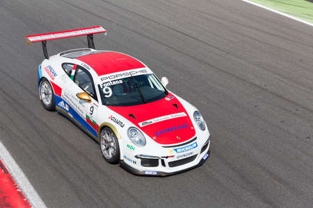gt3: Monza, Italy - May 30, 2015: Porsche 911 GT3 Cup of Ghinzani Arco Motorsport team, driven  by Andrea Fontana during the Porsche Carrera Cup Italia - Race in Autodromo Nazionale di Monza Circuit on May 30, 2015 in Monza, Italy.
