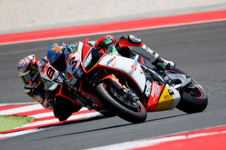 adriatico: Misano Adriatico, Italy - June 21, 2015: Aprilia RSV4 RF of Aprilia Racing Team , driven by Biaggi Max in action during the Superbike Race 2 during the FIM Superbike World Championship - Race at Misano World Circuit on June 21, 2015 in Misano Adriatico, I