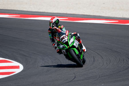adriatico: Misano Adriatico, Italy - June 21, 2015: Kawasaki ZX-10R of KAWASAKI RACING TEAM, driven by REA Jonathan in action during the Superbike Race 2 during the FIM Superbike World Championship - Race at Misano World Circuit on June 21, 2015 in Misano Adriatico, Editorial