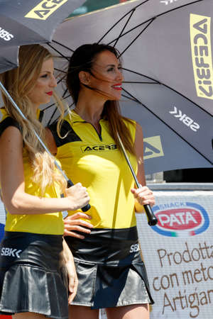 adriatico: MISANO ADRIATICO, ITALY - JUNE 21, 2015: A grid girl poses during the Superbike race 2 during the FIM Superbike World Championship - Race at Misano World Circuit on June 21, 2015 in Misano Adriatico, Italy.