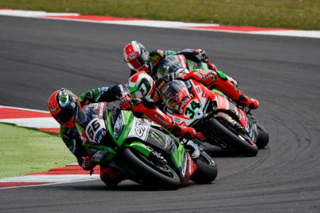 adriatico: Misano Adriatico, Italy - June 21, 2015: Kawasaki ZX-10R of KAWASAKI RACING TEAM, driven by SYKES Tom in action during the Superbike Race 2 during the FIM Superbike World Championship - Race at Misano World Circuit on June 21, 2015 in Misano Adriatico, It Editorial