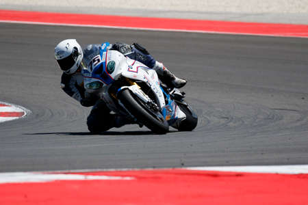 adriatico: Misano Adriatico, Italy - June 21, 2015: BMW S1000 RR of BMW Team Toth, driven by RIZMAYER Gábor in action during the Superbike Race 2 during the FIM Superbike World Championship - Race at Misano World Circuit on June 21, 2015 in Misano Adriatico, Italy. Editorial