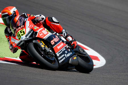 superbike: Misano Adriatico, Italy - June 21, 2015: Ducati Panigale R of Aruba.it Racing-Ducati SBK Team, driven by Michele Pirro in action during the Superbike Race 2 during the FIM Superbike World Championship - Race at Misano World Circuit on June 21, 2015 in Mis