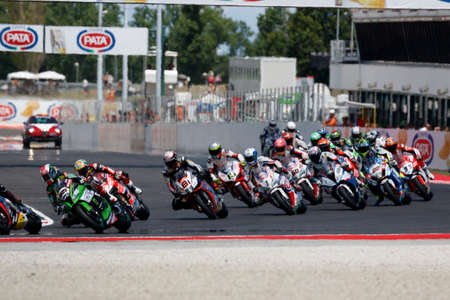 adriatico: Misano Adriatico, Italy - June 21, 2015: Bikes prepare to leave the grid at the start during race one at the Misano World Circuit on  during the FIM Superbike World Championship - Race at Misano World Circuit on June 21, 2015 in Misano Adriatico, Italy.