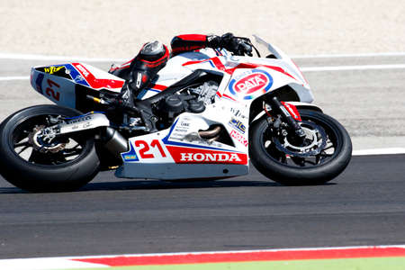 cig: Misano Adriatico, Italy - June 21: Honda CBR 650F of WILsport – CIG Team, driven by BIDDLE Avalon in action during the European Junior Cup  the FIM Superbike World Championship - Race at Misano World Circuit on June 21, 2015 in Misano Adriatico, Italy.