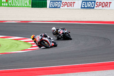 adriatico: Misano Adriatico, Italy - June 20, 2015: Kawasaki ZX-10R of ClasitalyTeam, driven by CAVALLI Francesco in action during the Superstock 1000 Qualifying during the FIM Superstock 1000 - race at Misano World Circuit on June 20, 2015 in Misano Adriatico, Ital