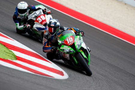 adriatico: Misano Adriatico, Italy - June 20, 2015: Kawasaki ZX-10R of Pedercini Team, driven by WAGNER Aiden in action during the Superstock 1000 Qualifying during the FIM Superstock 1000 - race at Misano World Circuit on June 20, 2015 in Misano Adriatico, Italy.