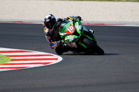 wagner: Misano Adriatico, Italy - June 20, 2015: Kawasaki ZX-10R of Pedercini Team, driven by WAGNER Aiden in action during the Superstock 1000 Free Practice 3 during the FIM Superstock 1000 - race at Misano World Circuit on June 20, 2015 in Misano Adriatico, Ita Editorial