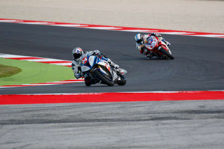 adriatico: Misano Adriatico, Italy - June 20, 2015: BMW S1000 RR of Team ASPI, driven by LUSSIANA Matthieu in action during the Superstock 1000 Free Practice 3 during the FIM Superstock 1000 - race at Misano World Circuit on June 20, 2015 in Misano Adriatico, Italy.