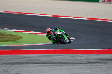 adriatico: Misano Adriatico, Italy - June 20, 2015: Kawasaki ZX-10R of Team Pedercini, driven by STARING Bryan in action during the Superstock 1000 Free Practice 3 during the FIM Superstock 1000 - race at Misano World Circuit on June 20, 2015 in Misano Adriatico, It