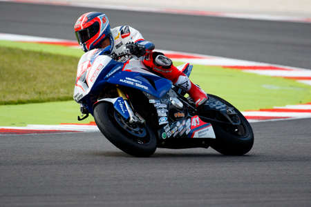 fda: Misano Adriatico, Italy - June 20, 2015: BMW S1000 RR of FDA Racing Team, driven by DANNUNZIO Federico  in action during the Superstock 1000 Free Practice 3 during the FIM Superstock 1000 - race at Misano World Circuit on June 20, 2015 in Misano Adriatic
