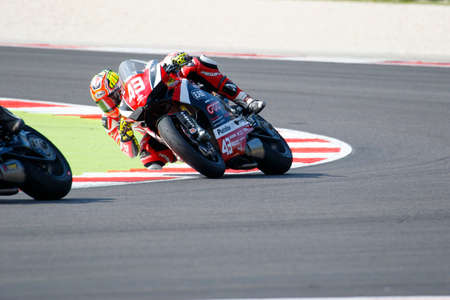 adriatico: Misano Adriatico, Italy - June 20, 2015: Ducati 1199 Panigale R of EAB Racing Team, driven by MASSEI Fabio  in action during the Superstock 1000 Free Practice 3 during the FIM Superstock 1000 - race at Misano World Circuit on June 20, 2015 in Misano Adria