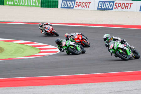 adriatico: Misano Adriatico, Italy - June 20, 2015: Kawasaki ZX-10R of Team Pedercini, driven by SEBESTYEN Peter in action during the Superstock 1000 Qualifying during the FIM Superstock 1000 - race at Misano World Circuit on June 20, 2015 in Misano Adriatico, Italy Editorial