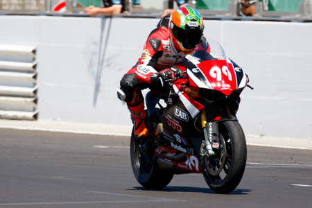 adriatico: Misano Adriatico, Italy - June 21, 2015: Ducati 1199 Panigale R of EAB Racing Team, driven by COVENA Tony in action during the Superstock 1000 Race during the FIM Superstock 1000 - race at Misano World Circuit on June 21, 2015 in Misano Adriatico, Italy.