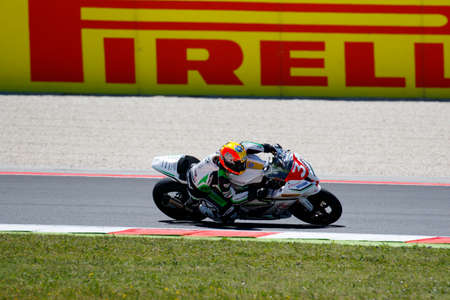 adriatico: Misano Adriatico, Italy - June 21, 2015: Kawasaki ZX-10R of Team BSR, driven by SUCHET Sebastien (SUC) in action during the Superstock 1000 Race during the FIM Superstock 1000 - race at Misano World Circuit on June 21, 2015 in Misano Adriatico, Italy. Editorial