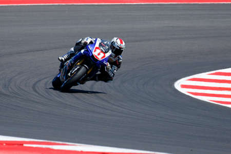 adriatico: Misano Adriatico, Italy - June 21, 2015: Yamaha YZF R1 of Trasimeno Team, driven by GUARNONI Jeremy in action during the Superstock 1000 Race during the FIM Superstock 1000 - race at Misano World Circuit on June 21, 2015 in Misano Adriatico, Italy.
