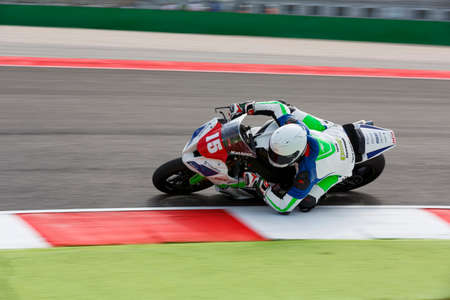 adriatico: Misano Adriatico, Italy - June 21, 2015: Kawasaki ZX-10R of OGP Team, driven by DUMAS Mathieu in action during the Superstock 1000 Race during the FIM Superstock 1000 - race at Misano World Circuit on June 21, 2015 in Misano Adriatico, Italy.