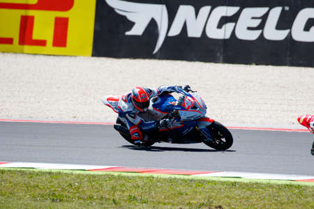 adriatico: Misano Adriatico, Italy - June 21, 2015: BMW S1000 RR of FDA Racing Team, driven by DANNUNZIO Federico  in action during the Superstock 1000 Race during the FIM Superstock 1000 - race at Misano World Circuit on June 21, 2015 in Misano Adriatico, Italy. Editorial