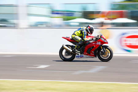 adriatico: Misano Adriatico, Italy - June 21, 2015: Kawasaki ZX-10R of Team18 Sapeurs Pompiers, driven by EGEA Stéphane in action during the Superstock 1000 Race during the FIM Superstock 1000 - race at Misano World Circuit on June 21, 2015 in Misano Adriatico, Ita